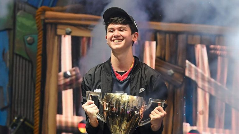 A photo of top gamer Bugha lifting the Fortnite World Cup in 2019